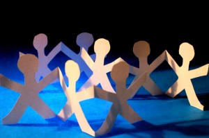 Paper cut-outs of people in a circle