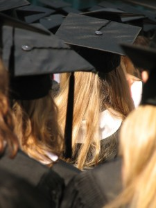 Photo of graduates wearing mortar boards and gowns