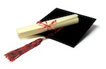 Photo of a mortar board hat and scroll