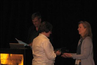 WebPA's Nicola Wilkinson receives the award from IMS' Lisa Mattson